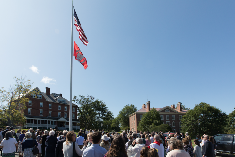 Raising the flags at the first Convocation on the New England campus (2019)