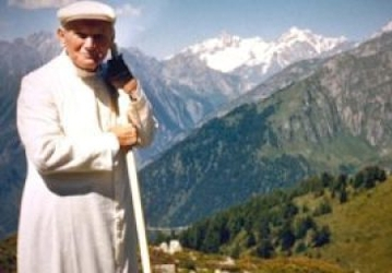 Pope St. John Paul II hiking with mountains in the background