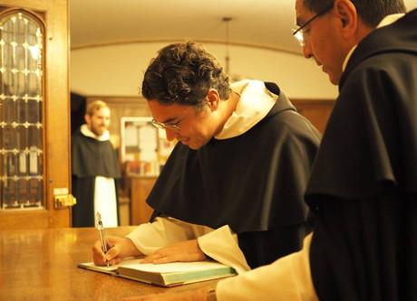 Br. Athanasius signs the Vestition book. (Photo: Western Dominican Novitiate)