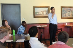 Nathan Haggard ('99) speaks with students in the campus coffee shop.