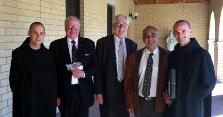 Rev. Patrick Carter, O.S.A. ('05), Governor Lloyd Noble, President Michael F. McLean, Dr. John Nieto ('89), and Rev. Peter Miller, O.S.A. ('07)
