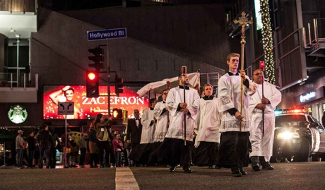 A group of Los Angeles priests and seminarians leading a Eucharistic procession down Hollywood Boulevard for the First World Day of the Poor.