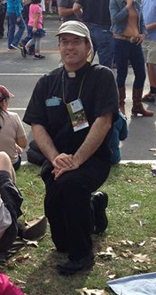 Rev. Ramon Decaen ('96) waits for the Popemobile to pass by in Philadelphia
