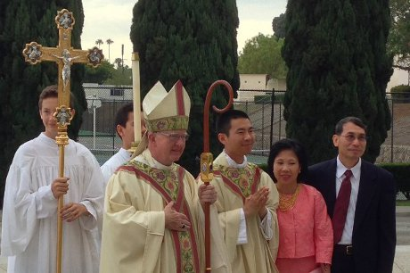 Rev. Jacob (Joseph '06) Hsieh with his parents and the Most Rev. Kevin William Vann, Bishop of Orange