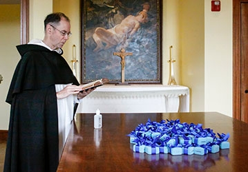 College Head Chaplain Rev. Paul Raftery, O.P., blesses the medals in Our Lady of the Most Holy Trinity Chapel