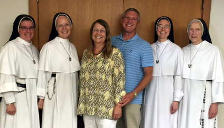 Rose (Teichert) and Daniel J. Grimm (both '76) with members of the Dominican Sisters of Mary, Mother of the Eucharist, on a recent fundraising trip