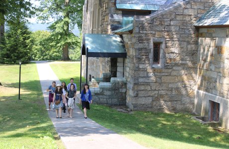 Students walk by chapel