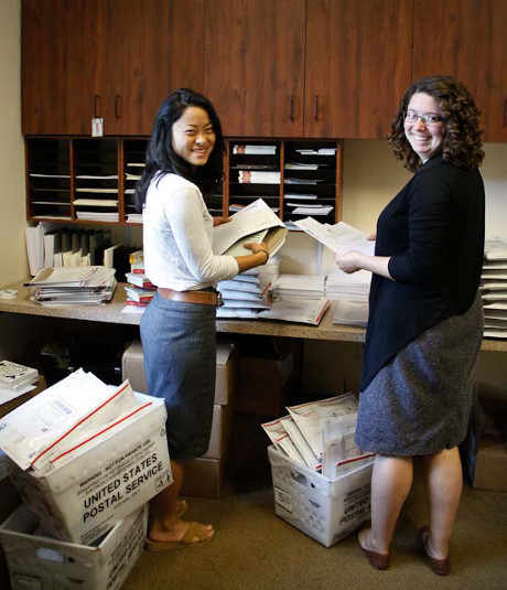 Admission staff prepare the readings for mailing