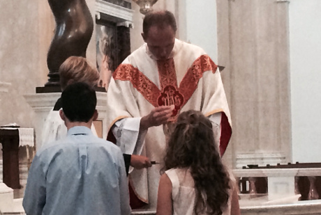 Fr. Nick distributes Holy Communion