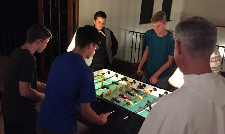Foosball with Fr. Sebastian in the men's residence hall