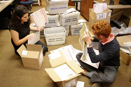 Admissions staff assemble the packets.