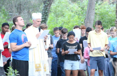 Fr. Sebastian leads students in the praying the Stations of the Cross