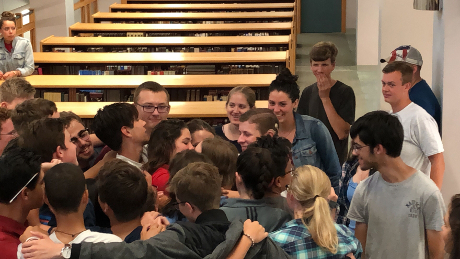 Students give Meg a group hug