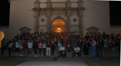 Students with candles standing in front of the Chapel