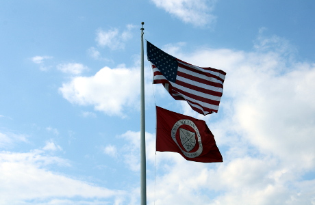 US and TAC flags flying over New England campus