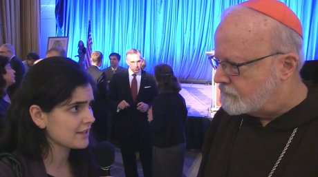 Lauretta Brown ('13) interviews Sean Cardinal O'Malley, Archbishop of Boston, at the National Catholic Prayer Breakfast in 2014.