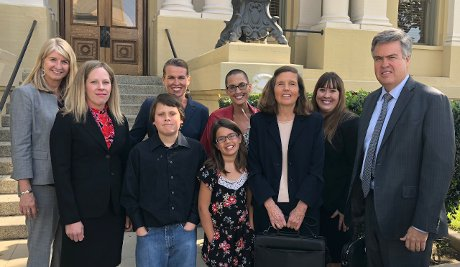 "Life Legal attorneys, including Katie Short ('80, third from right), with the family of Stephanie Packer, whose insurance company said it would pay for ""aid-in-dying"" drugs, but not the chemotherapy she needed."
