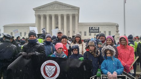 Members of the Washington, D.C., Board of Regents and their families outside the U.S. Supreme Court