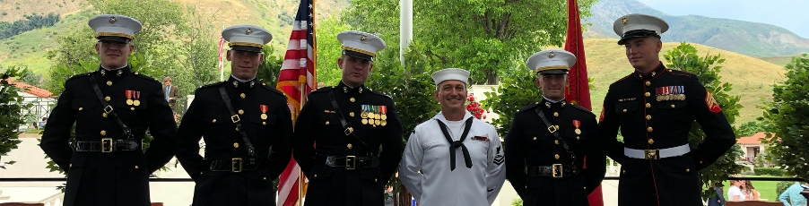 Alumnus Presents Two Graduates with Marine Corps Commissions