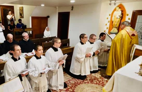 Br. Edward Seeley ('16), third kneeling from the left, enters the novitiate with the Canons Regular of the Immaculate Conception