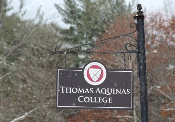 New England campus sign during the winter (2018)