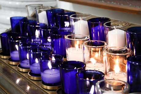 Votive candle rack in Our Lady of the Most Holy Trinity Chapel