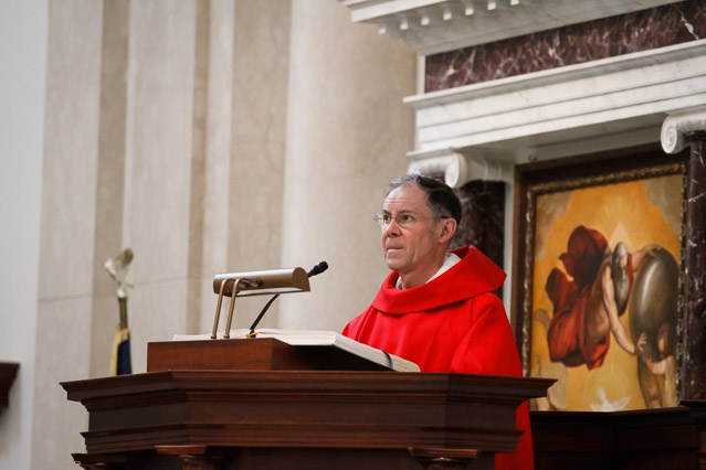 Fr. Paul proclaims the Gospel