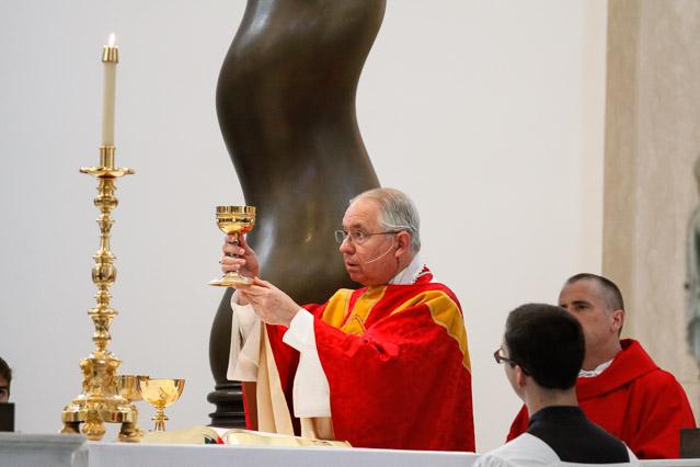 Archbishop Gomez raises the host