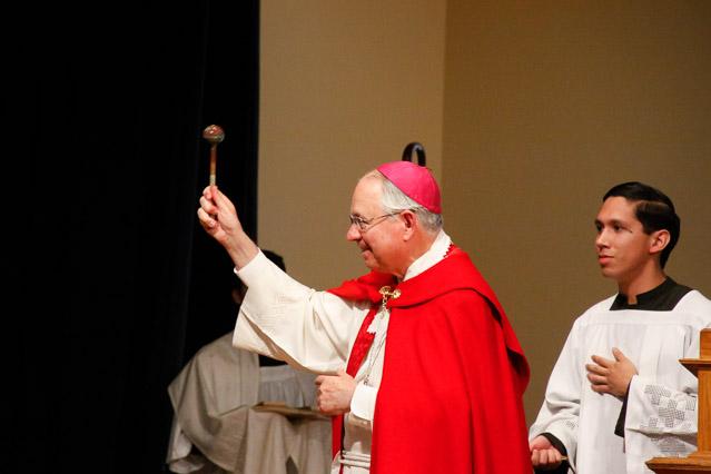 Archbishop Gomez sprinkles holy water.