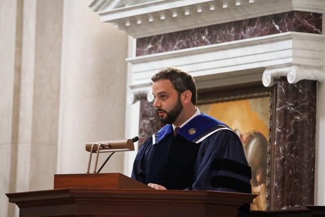 Tutor Dr. Stephen Shivone offers the prayers of the faithful.