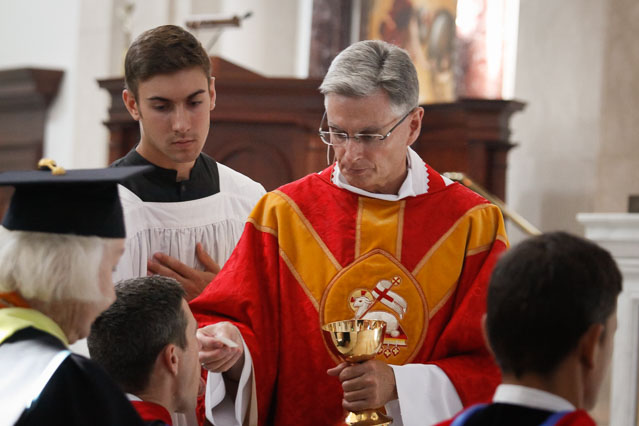 Bishop Daly distributes Holy Communion.