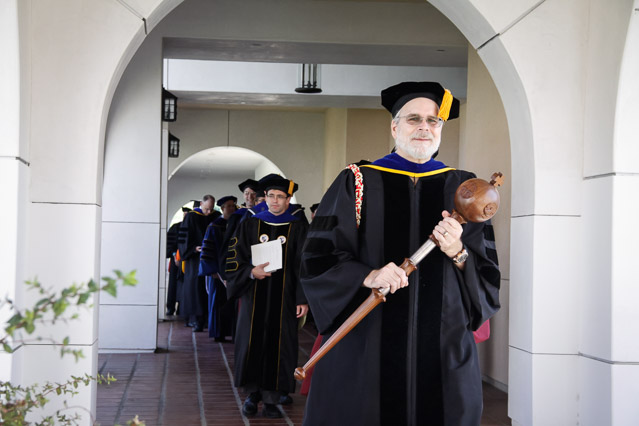 Members of the faculty process into St. Cecilia Hall.