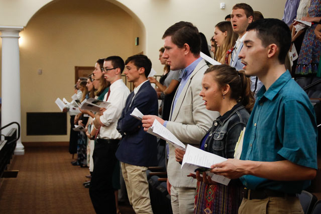 Students sing in St. Cecilia Hall
