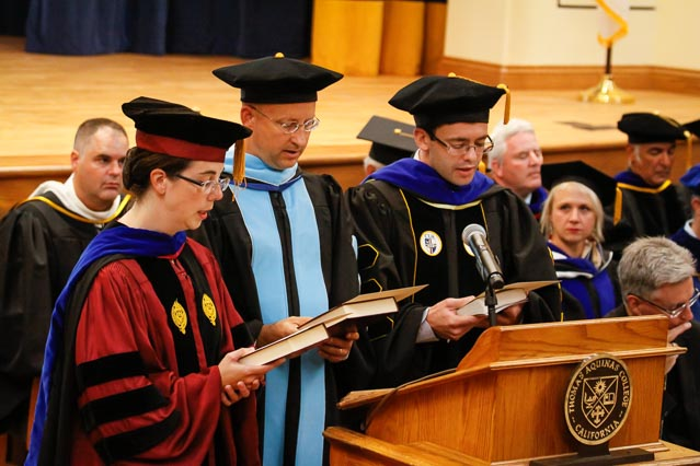 New tutors Dr. Margaret I. Hughes, Dr. Josef Froula, and Dr. Michael J. Rubin make the Profession of Faith and Oath of Fidelity