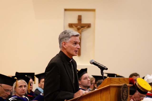 Bishop Daly addresses the Freshman Class.