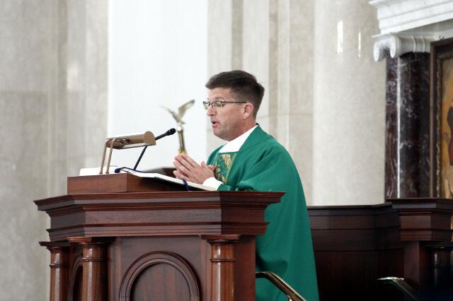 Rev. Gregory Dick, O.Praem, proclaims the Gospel