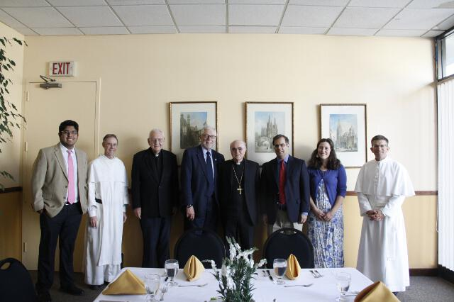 Jorge Moncada Hernandez ('18), Head Chaplain Rev. Paul Raftery, O.P., Chaplain Rev. Cornelius Buckley, S.J., President Michael F. McLean, Archbishop Viganò, Dean John J. Goyette, Barbara O'Brien ('18), and Fr. Gregory meet for lunch in St. Joseph Commons.