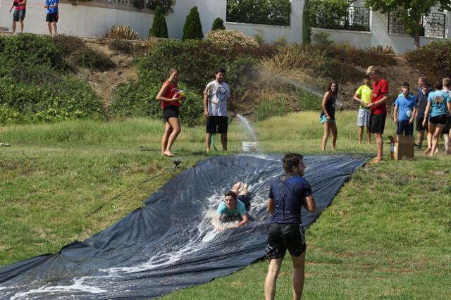Students dive on the slip-n-slide
