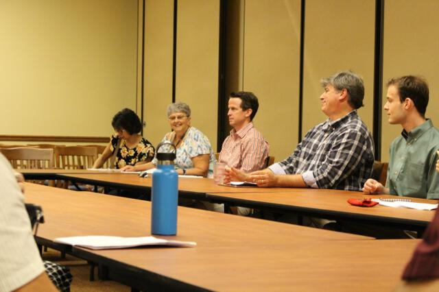 Parents and alumni participate in a seminar in the Dillon Discussion Room.