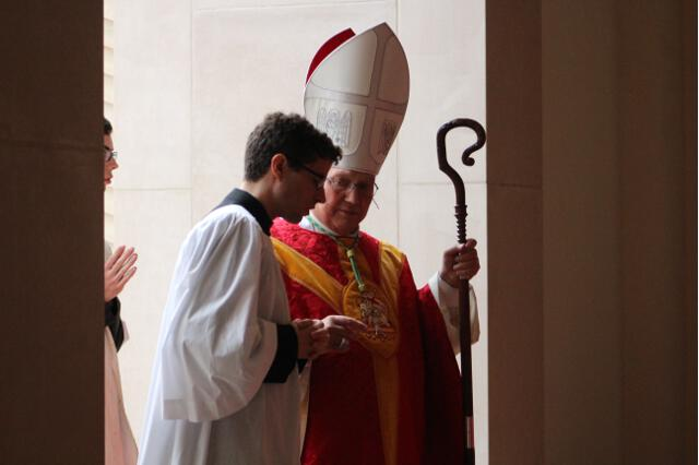 The principal celebrant and homilist, the Most Rev. Robert C. Morlino, Bishop of Madison, Wisconsin, and a student acolyte