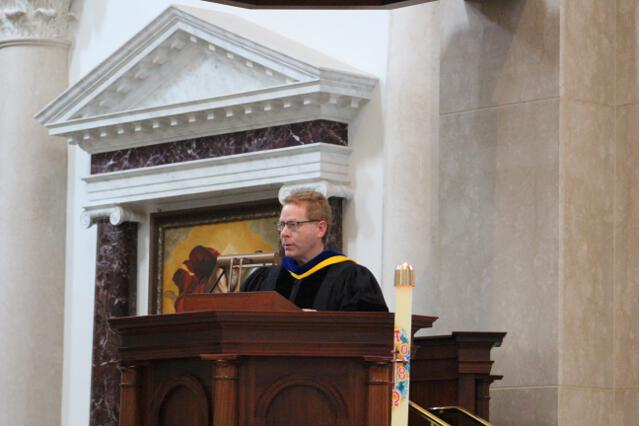 Tutor Dr. Brian T. Kelly delivers the first reading.