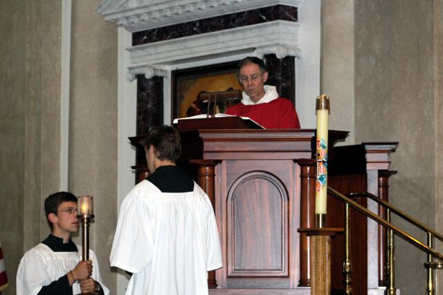 Head Chaplain Rev. Paul Raftery, O.P., proclaims the Gospel.