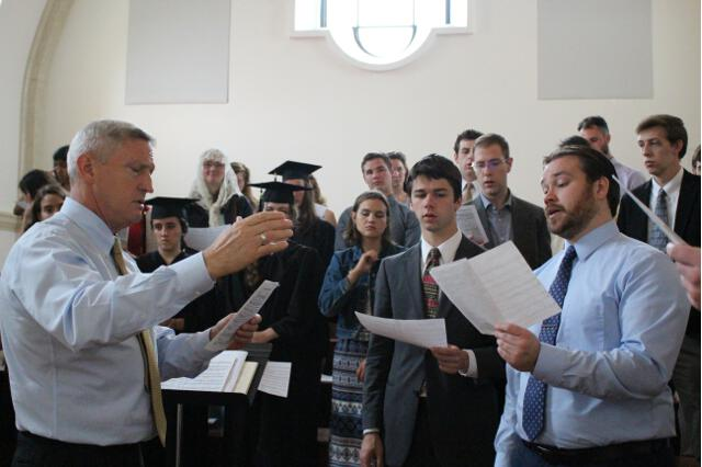 Dan Grimm ('76) directs the Thomas Aquinas College Choir in the Chapel choir loft.