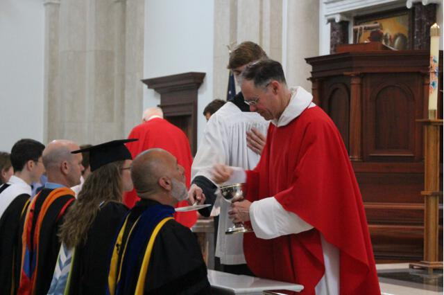 Fr. Raftery distributes Holy Communion.