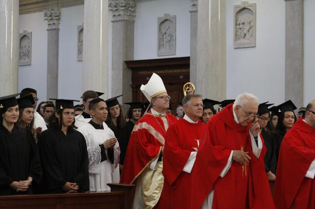 the Most Rev. Robert E. Barron, Auxiliary Bishop of Los Angeles, processes into the Chapel.