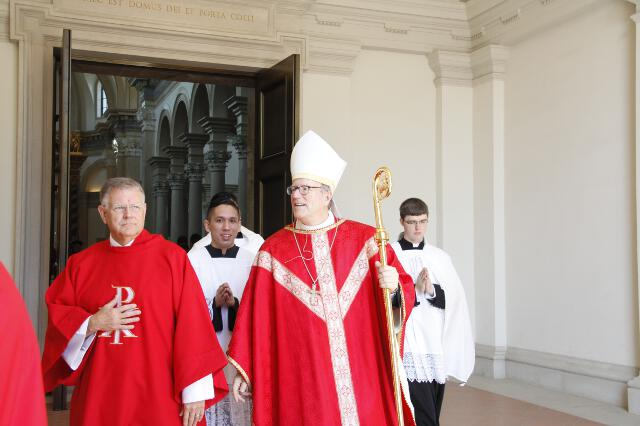 Bishop Barron leaves the Chapel after Mass.