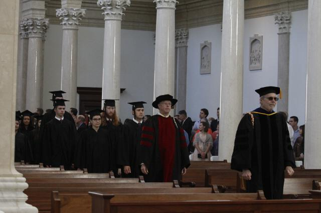 Members of the faculty process into the Chapel.