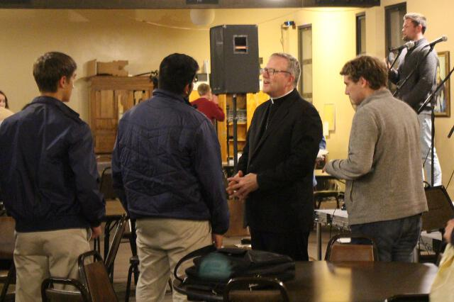 Bishop Barron visits with students.
