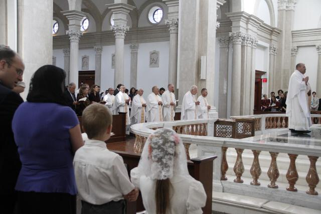 The altar party processes into Our Lady of the Most Holy Trinity Chapel.