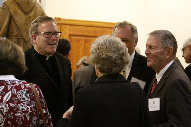 Bishop Barron with guests in St. Bernardine of Siena Library